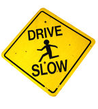 Drive slow sign. Closeup of drive slow warning sign with silhouetted figure running, isolated on white background Royalty Free Stock Photography