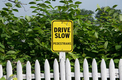 Drive Slow Sign. Yellow Drive Slow Pedestrians Sign Royalty Free Stock Image
