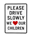 Drive slowly sign with red heart Royalty Free Stock Photography