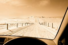 Drive on snowy street Royalty Free Stock Photo