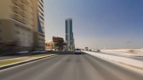 Drive on the streets of Ajman timelapse hyperlapse. Ajman is the capital of the emirate of Ajman in the United Arab Emirates. Drive on the streets of Ajman royalty free stock image