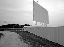 Drive-In Theater. A vintage drive-in movie theater in black and white Royalty Free Stock Image