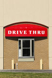 Drive Thru. A window and drive thru sign on a brick building Stock Images