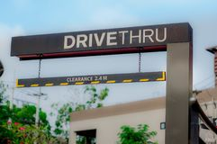 Drive thru and stop to buy food in the daytime. Convenience to buy food at haste time Stock Images