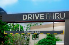 Drive thru and stop to buy food in the daytime. Convenience to buy food at haste time Royalty Free Stock Photography