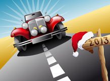 Drive to Xmas and New Year. Illustration of a sporty red luxury car coming down the road towards a sign with Santa's hat and 2013 Royalty Free Stock Photography