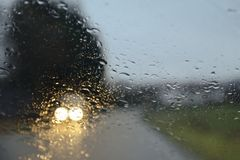 Drive under the rain Royalty Free Stock Photo