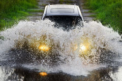Drive through water Royalty Free Stock Images