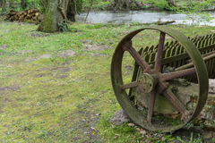 Drive wheel of an old rustic water mill Royalty Free Stock Image