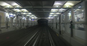 Driveless underground train coming to the station stock footage