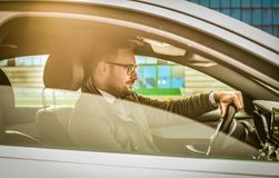 Driven by success. Business young man driving car stock photos