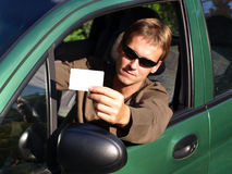 Driver. Young man holding driver's licence royalty free stock photos
