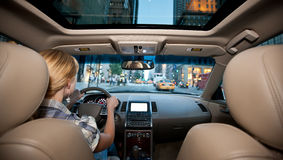 Driver. Image of young woman driving in the city Royalty Free Stock Photos