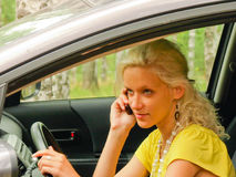Driver. Women talking on the mobile phone in the car Royalty Free Stock Images