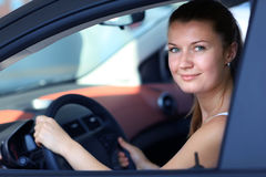 Driver. Smiling young female driver Stock Image