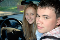 Driver. With girl in the car Royalty Free Stock Photos