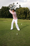 Driver. Young golfer during a shot with his driver Royalty Free Stock Image
