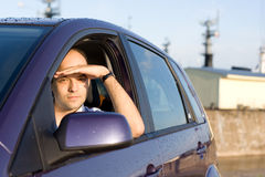 Driver. Men in his car on the pier Royalty Free Stock Image
