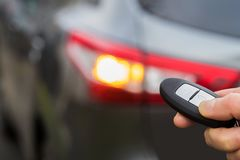 Close Up Of Driver Activating Car Security System With Key Fob. Driver Activating Car Security System With Key Fob Royalty Free Stock Photography