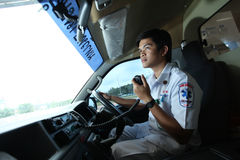 Driver of ambulance contacts team with radio communication Stock Images