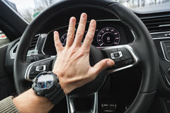 Driver angry pushes a steering wheel klaxon Royalty Free Stock Photos