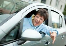 Driver arrabbiato Shouts della donna Fotografia Stock