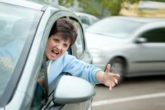 Driver arrabbiato Shouts della donna Fotografia Stock Libera da Diritti