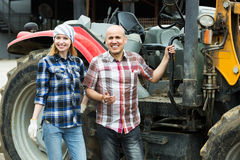 Driver and assistant near harvester Royalty Free Stock Photo