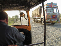 Driver of an auto rickshaw taxis on a road Stock Photo