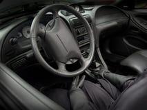 Driver in automobile Immagine Stock