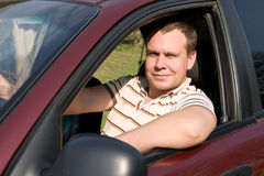 Driver behind the wheel of a car Stock Photos