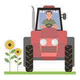 Driver behind the wheel of the tractor Royalty Free Stock Photography