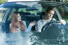 Driver bored with female passenger. Young men bored with his female passenger Stock Image