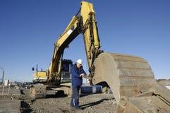Driver and bulldozer stock photo
