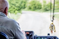 Driver of bus confidently manages a vehicle, riding on rural r stock images