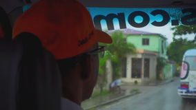 The driver in the cap in the car during rainy weather stock footage