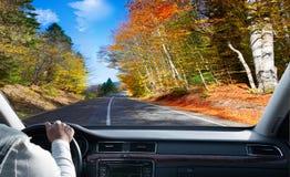 Driver in car.  asphalt road Stock Photo