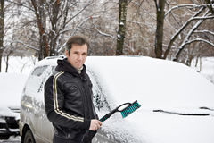 Driver of car with brush around in snow on winter Royalty Free Stock Photography