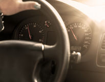 Driver in car holding steering wheel. Sunny day Stock Photos