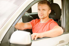Driver of car looks Stock Photo