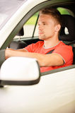 Driver of car looks Stock Photography