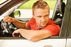 Driver of car looks back Stock Image
