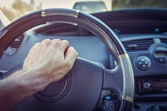 Driver in the car presses tone button on steering wheel. Driver in the car presses tone button on steering wheel Stock Photo