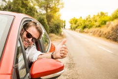 Driver in a car showing thumbs up gesture Stock Photography
