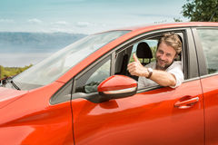 Driver in a car showing thumbs up gesture Stock Images
