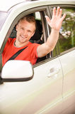 Driver of car waves hand Royalty Free Stock Photos