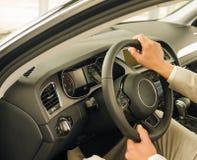 Driver at car wheel Stock Image