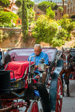 Driver in the carriage on the square Colosseum Royalty Free Stock Photos