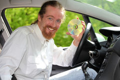 Driver with CD Royalty Free Stock Images