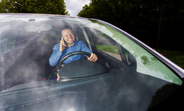 Driver and cellphone Royalty Free Stock Photos